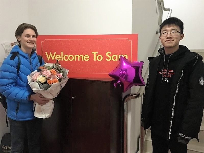 Exchange student Sam Guyer welcomed by his host family brother Mark